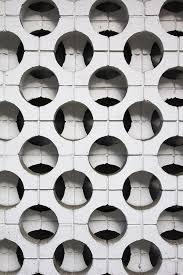 brutalist architecture cheek to cheek with modern designs