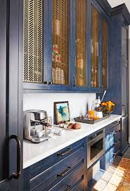 kitchen cabinet ideas metal grate cabinet fronts are our favorite kitchen trend