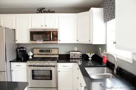 White Kitchen Cabinets White Appliances Kitchen Remodel With Blue Backsplash And Cool Ceiling Fan Also