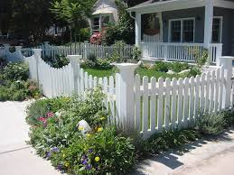 white picket fences landscape contemporary with cottage garden