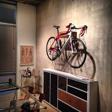 splendid mounted on wall bike with accessories on white wall