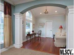 i love how they use columns to separate the dining room home