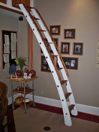 balcony library ladder that can be stored in a horizontal