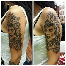 collection of 25 flowers n sugar skull on back for