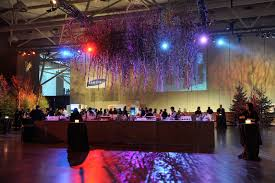 a canopy of trees hung above the bar for the cocktail reception