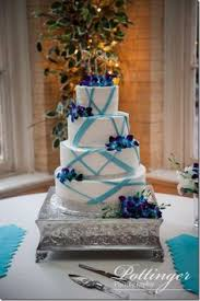 tiffany blue and purple wedding cake with hydrangeas and willow