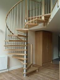 stainless silver wrought iron spiral staircase with brown wooden