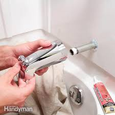 cutaway photos show how to replace the three most common types of bathtub spouts when they are leaking or broken