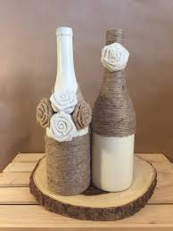 cream colored wine bottle wrapped in twine and burlap with