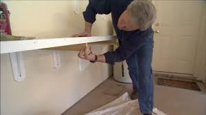 how to attach a countertop to a wall without cabinets how to build a countertop garage workbench today s homeowner
