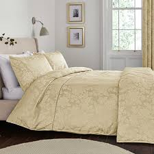 White And Cream Bedding Cream Wooden Bed With White Bedding Gold Pillows And Duvet Black
