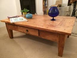 unusual rustic solid oak coffee table with hidden drawer in