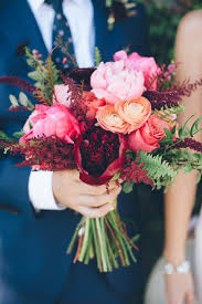 fall bridal bouquets dramatic fall wedding bouquet of peonies ranunculus roses and