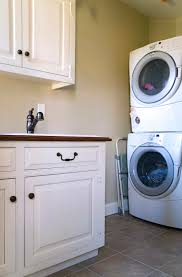 small basement laundry room design after makeover with stacked