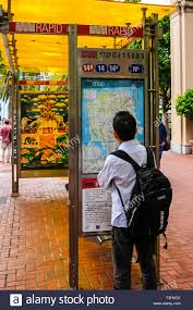 San Francisco Tram Map by A Man Reading The Timetable And Map Of The Public Tram System In