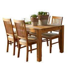 the hannover oak dining room table and 4 fabric chairs for only 449