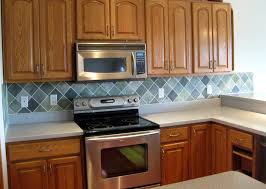 gray cream back splash with rhombus shape combined with brown