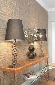 awesome wall seagrass wallpaper in the entryway to give guests a