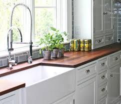 modern kitchen island with walnut wooden countertop and oak wooden