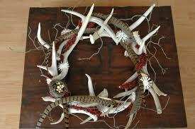 fake deer unpredictable christmas wreath decorating idea with fake deer