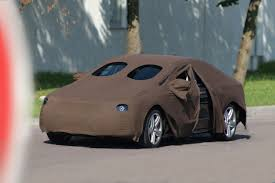 camo wrapped cars the art of car disguise prototype camouflage decoded by car magazine