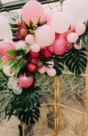 bae flowers and balloon at a boho bash boho holidays and birthday centerpieces