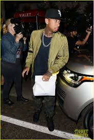 tyga yellow bentley kylie jenner u0026 tyga wear matching green for dinner photo