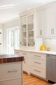 kitchen cabinet handle ideas a stainless steel oven range sits against white herringbone