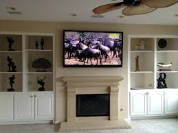 Mounting Tv Over Brick Fireplace by Fireplace Entrancing Hang Tv Over Fireplace For Living Ideas