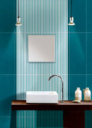 interior blue ocean tile over green tosca wallpaper pattern