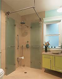 its centerpiece is an accordion style shower stall with frosted