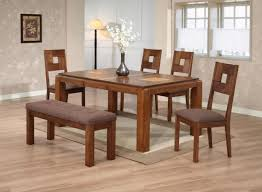 two tone brown lined area rug set under oak kitchen table with