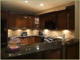 Kitchen Design Black Granite Countertops - granite countertop wooden worktop kitchen microwavable cups