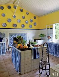 blue kitchen cabinets and yellow walls 27 kitchens with colorful accents architectural digest