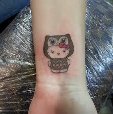 hello kitty finger tattoo hello kitty tattoo ideas popsugar