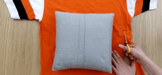 Upcycle Old Tshirts - how to turn t shirts into no sew pillow covers tiphero