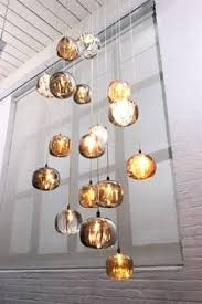 hanging light cluster with infinity pendant fixture by pomp