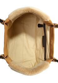 ugg boots bags accessories on sale up to 70 at tradesy ugg bailey button triplet sand sale ugg heritage handbag