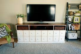 cool white and brown wooden media console featuring small square