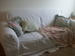 shabby chic sofa covers my living room is a mess but i can t afford upholstery laurel home