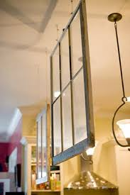 hanging old windows as a room divider so clever simple