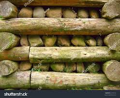retaining wall made wooden logs rock stock photo 2172516
