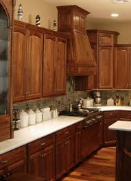 wooden walnut kitchen cabinets in the kitchen designed with white