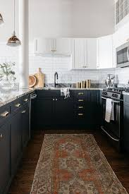 two tone kitchen cabinets with black countertops black and white kitchen cabinets with polished brass cup