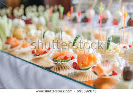 cucumber canapes different canapes smoked salmon cucumber stock photo 693592873
