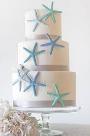 6 beautiful beach wedding cakes decorated with shells and sea life