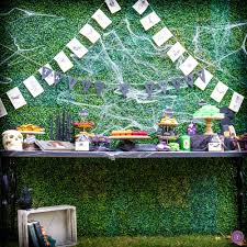 black dessert table and hedge wall backdrop from teak u0026 lace