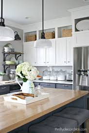 oak wood saddle glass panel door floor to ceiling kitchen cabinets