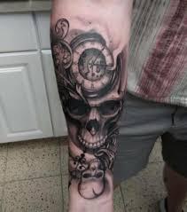 skull and clock half sleeve tattoos center