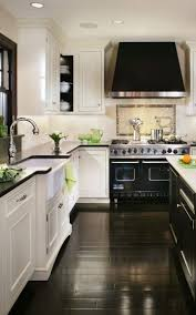 Grey Wood Floors Kitchen by White Kitchen Cabinets Dark Tile Floor Outofhome